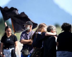 People comfort one another on the Whakatane Wharf on Tuesday morning. Photo: Getty Images