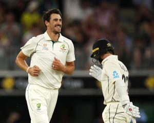 Mitchell Starc celebrates dismissing New Zealand captain Kane Williamson. Photo: Getty