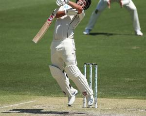 Colin de Grandhomme was given out caught after being struck on the helmet by Mitchell Starc....