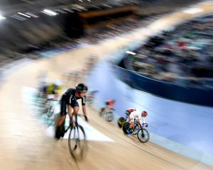 Aaron Gate, of New Zealand, on his way to winning the final of the men's omnium at the UCI Track...