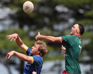 Otago's Isaiah Duncanson (left) and Wairarapa Bush's Rihi Brown compete for the ball during a...