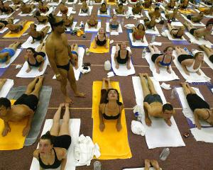Yoga guru Bikram Choudhury (standing) at the Bikram Yoga College of India in Los Angeles. Photo:...