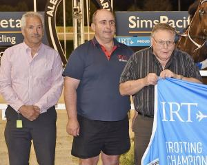 Trainer Phil Williamson (left) and Griffins Syndicate members Rob McIntosh (centre) and Greg...