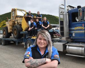 Emalee Millar (26) and fellow Otago Polytechnic automotive students show off the programme's...