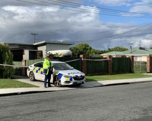 A cordon remains in place at the property on Oreti St this morning. Photo: Abbey Palmer