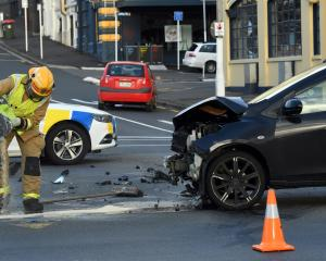 Emergency services were called to a crash on Crawford St just after 6.30am. Photo: Stephen Jaquiery