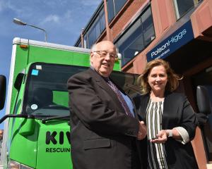 Dunedin Casino Charitable Trust chairman Stan Rodger hands over the keys to a new delivery truck...