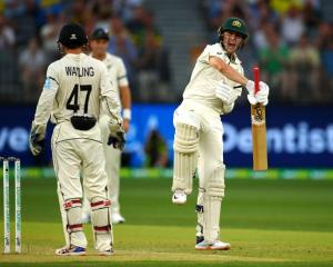 Marnus Labuschagne celebrates his century as BJ Watling watches on in Perth last night. Photo:...