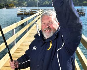 Keen fisherman Keith Malcolm prepares a sprat at the new fishing jetty at Boiler Point, Port...