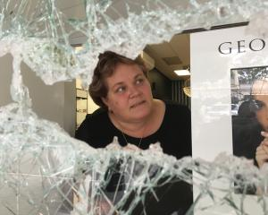 Ballantynes Showcase Jewellers owner Wendy Bradfield inspects damage to her shop in lower Thames...