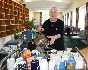 Pat Cross (80) pours a last cup of tea yesterday. PHOTO: LINDA ROBERTSON