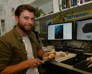 Jacob Blokland pictured with fossils in the Flinders University laboratory. Photo: Flinders...