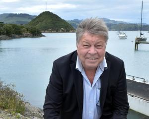 Enterprise Dunedin business relationship manager Des Adamson crouches near the Port Chalmers...
