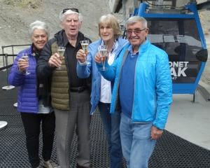 Toasting their first ride in a gondola at Coronet Peak yesterday are (from right) NZSki owner Sir...