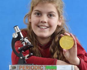 George Street Normal School pupil Beth Elder proudly displays the gold medal she won for gaining...