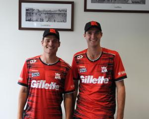 Ed Nuttal and Henry Shipley show off the Kings new uniform which they will debut at Hagley Oval...