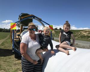 Fine weather has contractors out in force making winter feed. Sarah Byrne with children Liam (4)...
