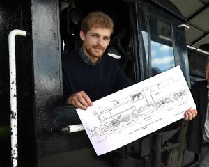 Sam Mackwell (left) and Nico Haima, of Christchurch firm Mackwell Locomotive Ltd, with plans for...
