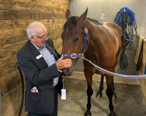 Australian priest Fr Brian Glasheen with his Interdominion Pacing Championship runner Triple...