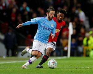 Manchester City's Bernardo Silva (L) in action with Manchester United's Angel Gomes. Photo: Reuters