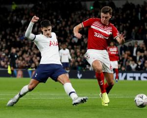 Tottenham Hotspur's Erik Lamela (L) scores their second goal against Middlesbrough. Photo: Reuters