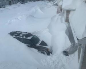 Snow piled up outside houses in St John's, Newfoundland And Labrador. Photo: J. David Mitchell...