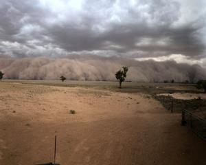A dust storm approaches a farm northwest of Dubbo in New South Wales on Sunday. Photo: social...