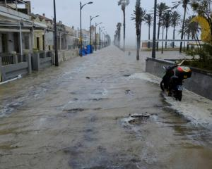 A flooded promenade next to the Patacona beach during the storm in Alboraya, near Valencia. Photo...