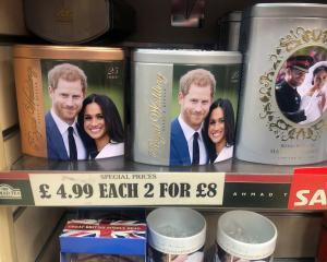 Discounted merchandise depicting Harry and Meghan displayed in a Windsor shop. Photo: Reuters