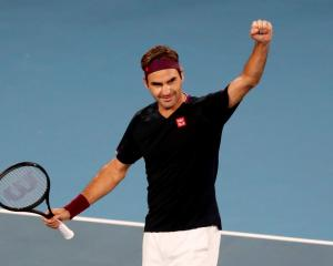 Roger Federer celebrates his win over John Millman. Photo: Reuters