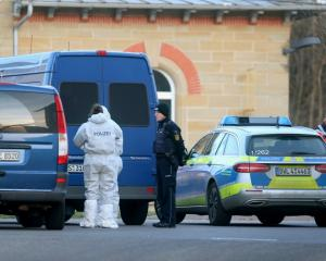 Forensic experts near the house in Rot am See where the shooting took place. Photo: Reuters