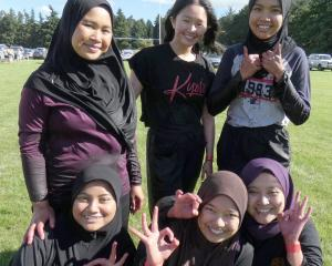 "Team ""Cherry Berries"", comprising (back left) Adlyn Abdul Halim, Gabriella Alexandra, Nurain..."