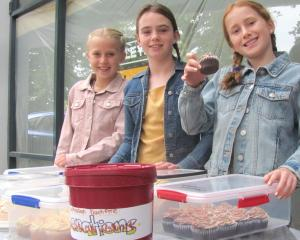 Maisie Player, 8, Piper Smith, 11, and Mya Player, 10, sell home baking in downtown Ashburton to...