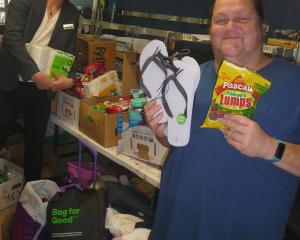 Methven Resort owner Ole Wallis (left) and Wendy White show some of the items donated by the...