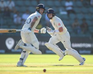 England batsmen Ben Stokes and Ollie Pope run between the wickets during their partnership...