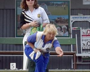 Beth Brown (Taieri) delivers a bowl while opponent Lee Grigg (Green Island) looks on. Brown...
