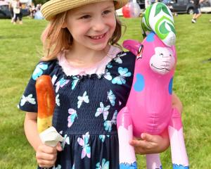 Showing off her new toy from the Brighton Gala Day, Delilah Pearson (4), of Dunedin, enjoys a hot...
