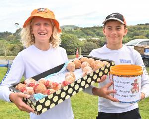 Selling donuts and collecting donations are Brighton Surf Life Saving Club members Aidan Blair ...