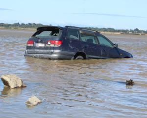 When the car was retrieved, the inside of it was filled with water and sand. Photo: Laura Smith