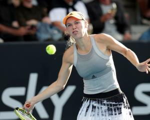 Caroline Wozniacki lines up a shot during her match at the ASB Classic yesterday. Photo: Getty...