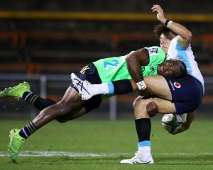 Chris Kuridrani tackles Mark Nawaqanitawase during the Highlanders' trial game against the...