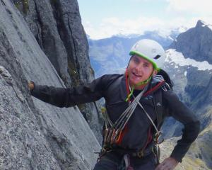 Conor Smith climbing Barrier Knob, in Fiordland in 2016. PHOTO: NEW ZEALAND ALPINE TEAM