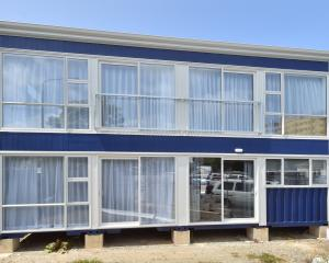 This Dunedin property was built from eight shipping containers. Landscaping is still to be...