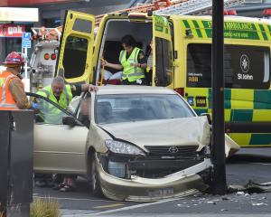 A St John Ambulance office checks on the driver of a car involved in an accident in Moray Place...