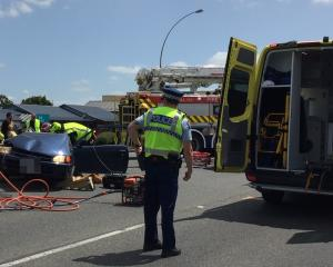 Emergency services at the scene of the crash in Invercargill today. Photo: Luisa Girao