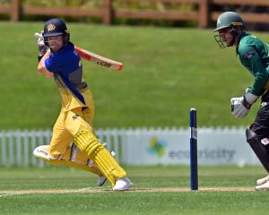 Otago batsman Nick Kelly hits the ball through the offside at the University of Otago Oval...