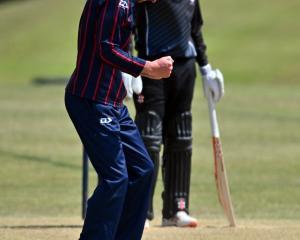 Carisbrook-Dunedin bowler Patrick Arnold celebrates trapping Kaikorai batsman Mitch Renwick lbw...