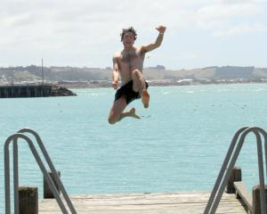 Celebrating his 26th birthday, Henry Elsom, of Oamaru, jumps off a jetty at Oamaru Harbour...