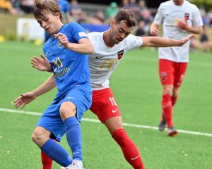 Southern United's Adam Hewson (left) and Canterbury United's Reece Dalton fight for the ball at...
