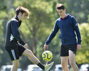 Josh Skryba and Ben Lund play with a ball at Logan Park Turf yesterday as they prepare to head to...